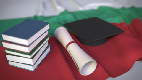 Graduation cap, books and diploma on the Bulgarian flag. Higher education in Live Action