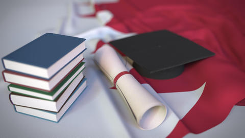 Graduation cap, books and diploma on the Bahraini flag. Higher education in Live Action