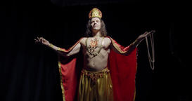 Indian deity Surya the God of sun is lifting his arms up, wearing a crown, 4k Live Action