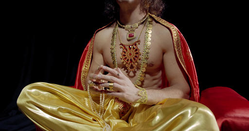 Surya the god of sun with a crown on his head is sitting in lotus position, 4k Live Action
