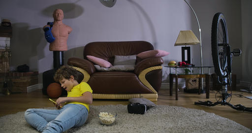 Timelapse of curly-haired child in casual clothes talking on smartphone and Live Action