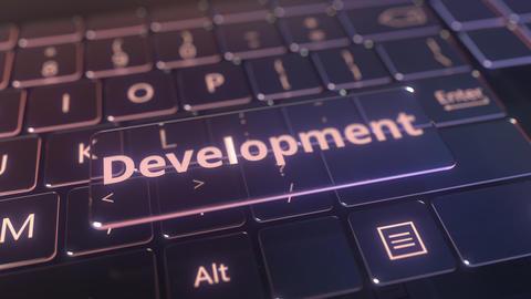 Futuristic computer keyboard and transparent development key. Conceptual 3D Live Action
