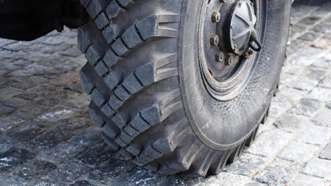 Wheel of a large lorry. Wheel tire on a military vehicle Live Action