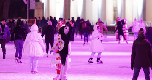 Animator dances among the skating Live Action