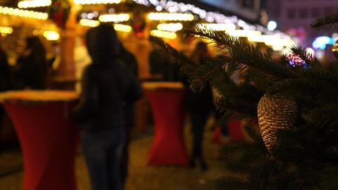 Christmas market at night time in Europe. Blured people in background. Colourful Live Action