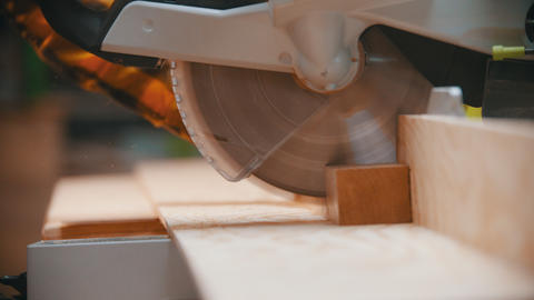 Carpentry - a woodworker cutting the wooden detail with a sharp circular saw Live Action