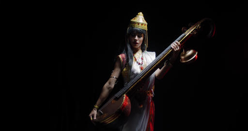Indian goddess of knowledge and music is holding veena and dancing, 4k Live Action