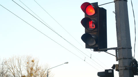 At the intersection, the traffic light switches from red to green Live Action