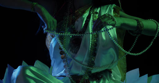 An indian goddess Saraswati wearing white dress is holding pearl beads, 4k Live Action