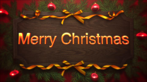 Animated closeup Merry Christmas text, red balls and green branch on wood background Animation