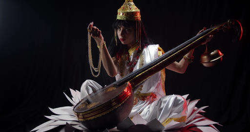 Ancient indian deity the goddess of knowledge Saraswati with her veena, 4k Live Action