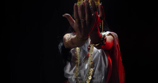 An indian deity, goddess Saraswati in white dress with jewelry, dancing, 4k Live Action
