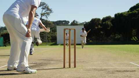 Bowler running out a player during cricket match Live Action