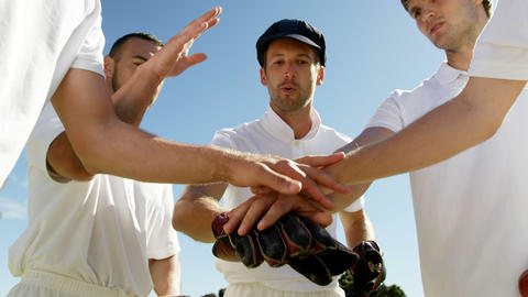 Cricket players forming a hand stack during cricket match Live Action