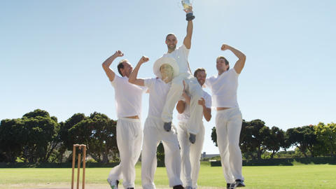Cricket team with trophy on cricket field Live Action