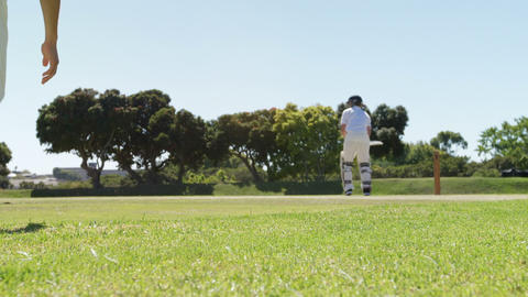 Batsman playing a sweep shot during cricket match Live Action