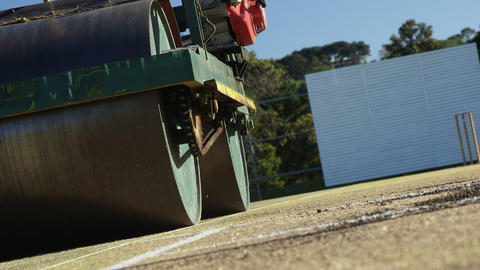 Cricket roller used to prepare pitch on cricket ground Live Action