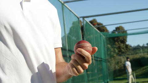 Cricket player holding ball during a practice session Live Action