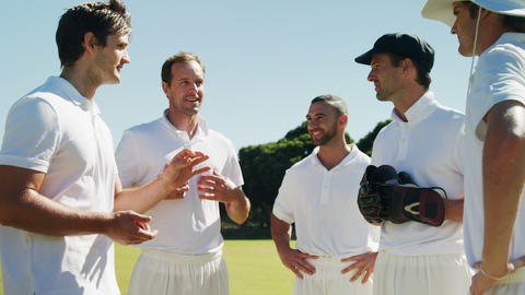 Cricket players into team discussion during cricket match Live Action