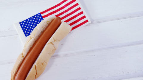 Hot dog on wooden table with 4th july theme Live Action