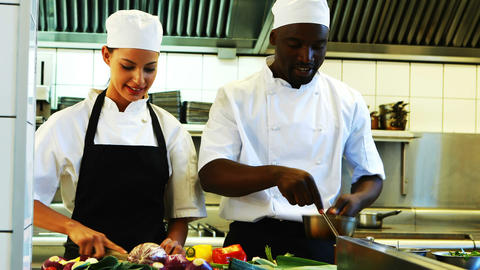Chefs preparing food in commercial kitchen Live Action