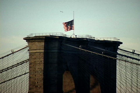 Manhattan Bridge with American Flag Stock Video Footage