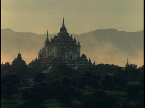 Fog rolls behind a majestic, ancient Buddhist temple in... Stock Video Footage