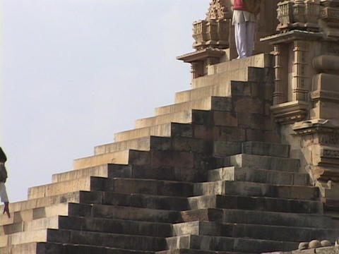 Hindu pilgrims climb the stone steps at Khajuraho Stock Video Footage