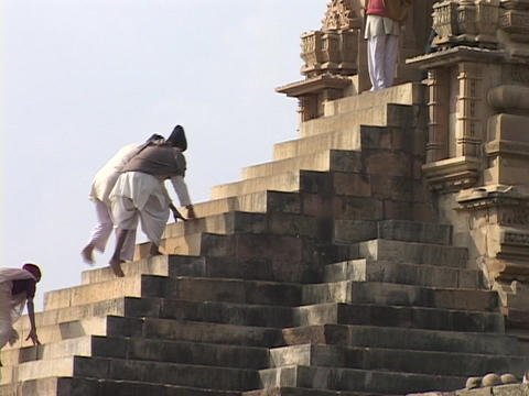 Hindu pilgrims climb the stone steps at Khajuraho Footage