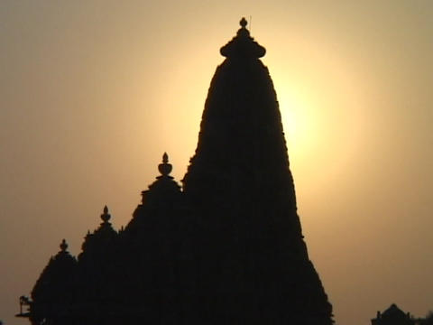 A spire on an Indian temple stands silhouetted against... Stock Video Footage