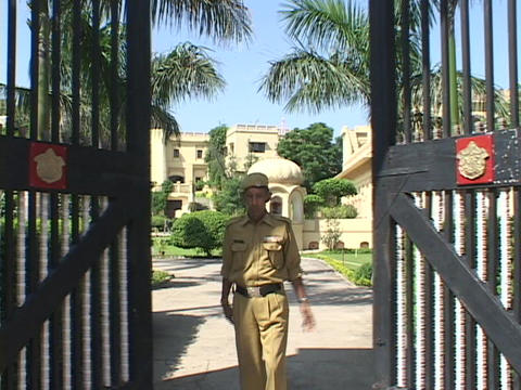 An army general opens palace gates and salutes Footage