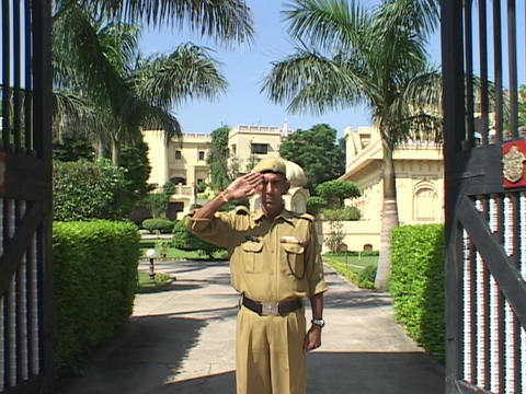 An army general opens palace gates and salutes Stock Video Footage