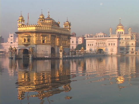 The Sikh Holy Temple reflects in the lake Stock Video Footage