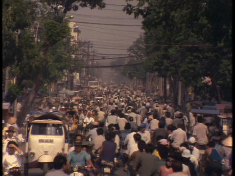 Bicycle traffic fills up the streets in Saigon Stock Video Footage