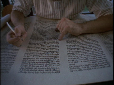 A calligrapher works on a Torah scroll Stock Video Footage