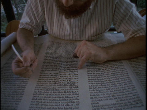 A calligrapher works on a Torah scroll Footage