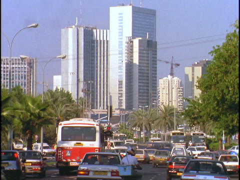 Skyscrapers tower over a busy street in Tel Aviv Stock Video Footage