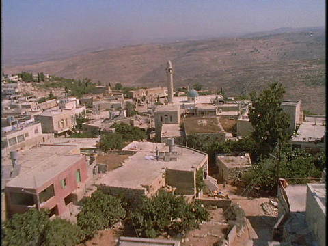 A mosque stands at the center of a Palestinian village in this amazing aerial shot Footage