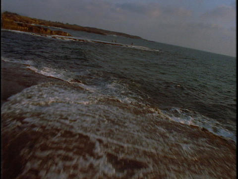Fishermen stand on the shore near the ocean Stock Video Footage