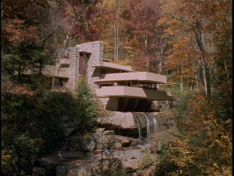 Water streams over the Frank Lloyd Wright Falling Water House in Pennsylvania Footage