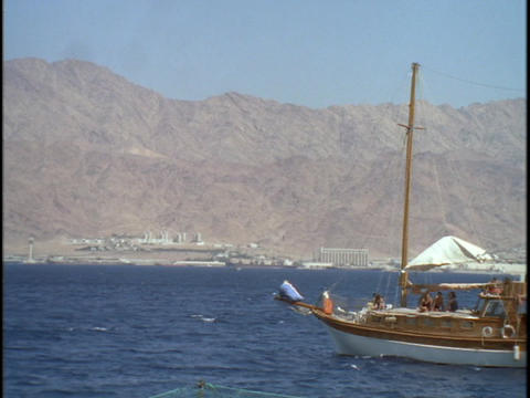 A sail boat sails near the desert Stock Video Footage