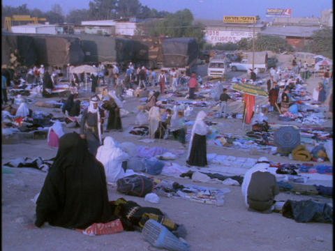 Vendors sell to shoppers at an Bedouin market Stock Video Footage