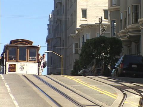 A cable car comes over the hill in San Francisco, California Stock Video Footage