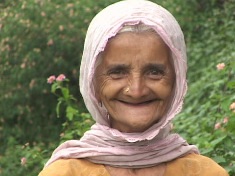 An Elderly Woman Laughs Out Loud stock footage