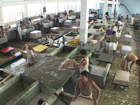 Workers mix and blend papers in a factory Stock Video Footage