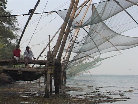 Fishing nets hang along a dock in Kerala, India Stock Video Footage