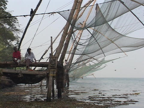 Fishing nets hang along a dock in Kerala, India Footage