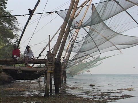 Fishing nets hang along a dock in Kerala, India Stock Video Footage