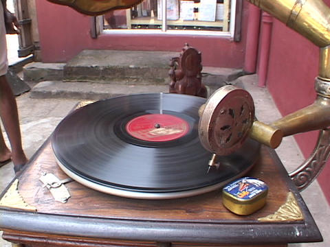A record spins on an old phonograph Live Action