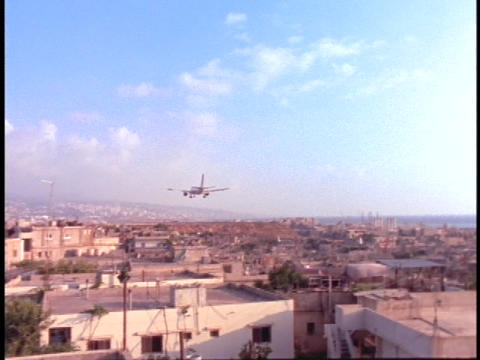 An airplane flies over Beirut, Lebanon Stock Video Footage